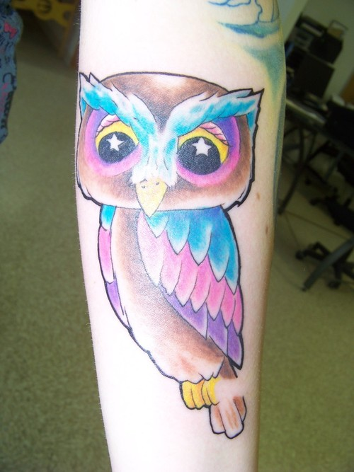 Cartoon owl with star eyes tattoo.