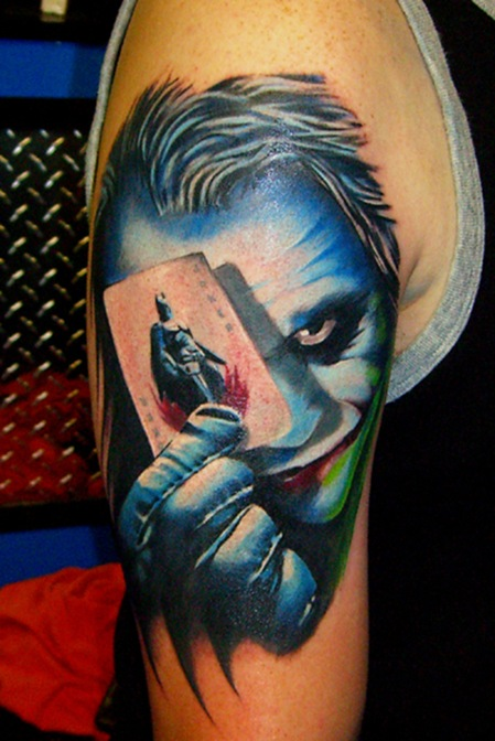 Movie joker tattoo with playing card.