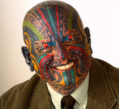 Colorful face tattoo.
