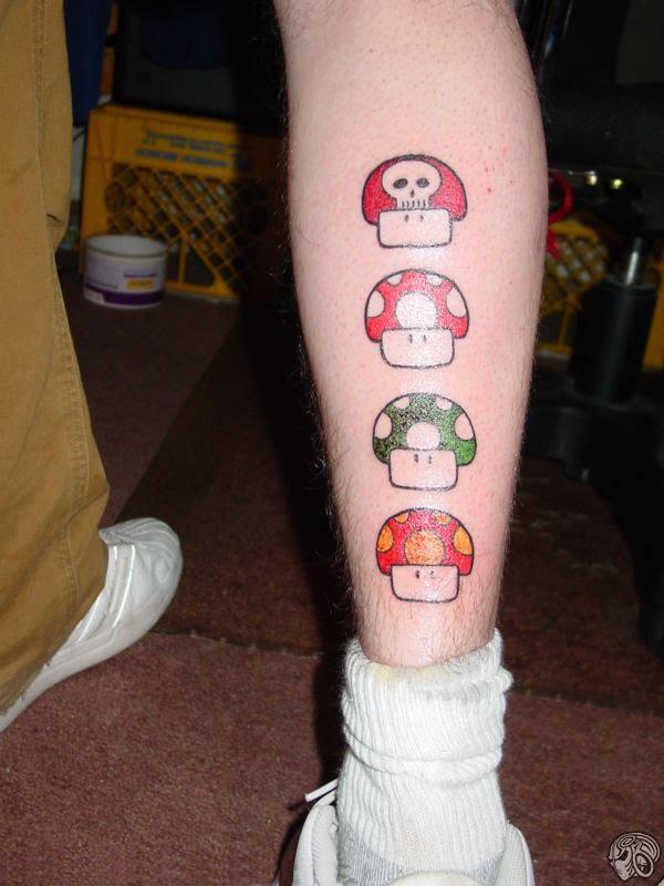 Mario mushrooms leg tattoo.