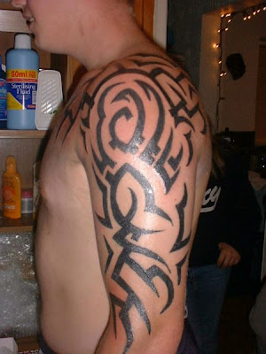 Puzzled tribal arm tattoo for guys.