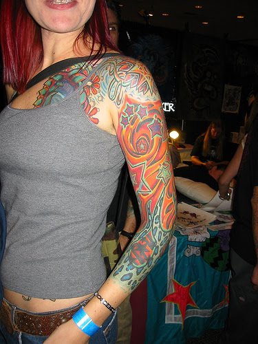 Sleeve tattoo with stars for women.