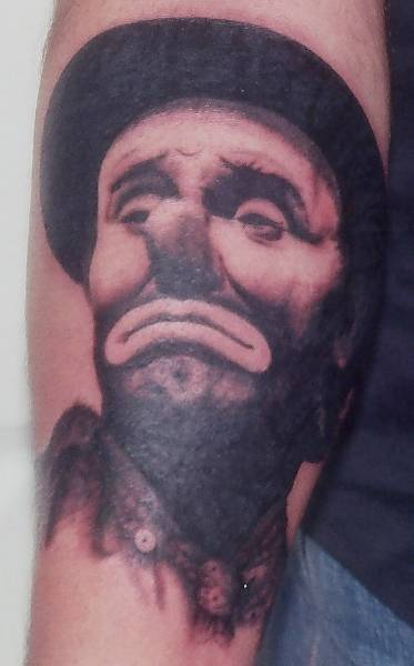 The most popular area for a clown tattoo seems to be the upper arm and lower