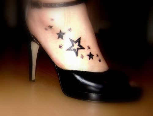 quarter sleeves tattoo henna foot tattoo. Stars lower back tattoo.
