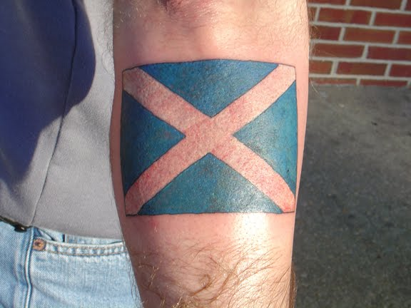 inspired flag tattoos, such as military, religious and pirate designs,