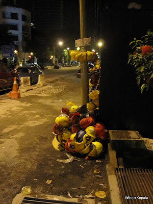 Unusual growth of safety helmets on trees and streetlights