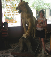 JD and Caitlin next to a stuffed lion