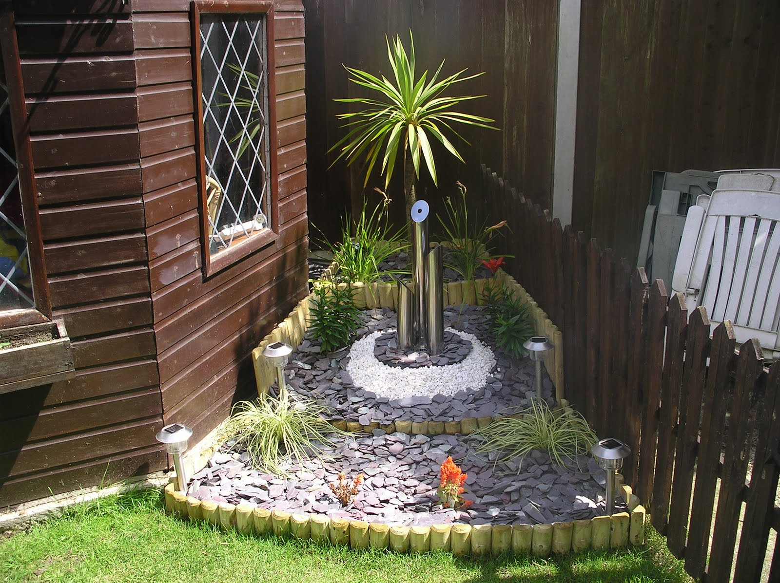 A Garden Feature Featuring A Garden Water Feature And A