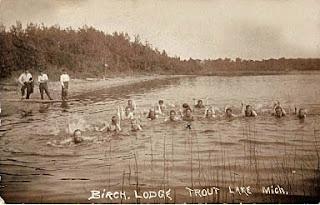 Birch Lodge, Trout Lake, MI enjoying the beach title=