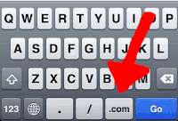 iPhone keyboard with .COM button.