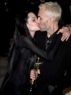 angelina jolie brother kiss. Angelina Jolie showed off her figure in a black