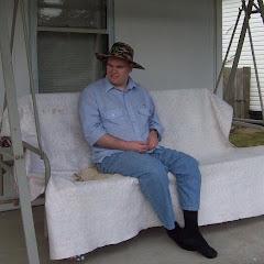 Preston sitting in his swing