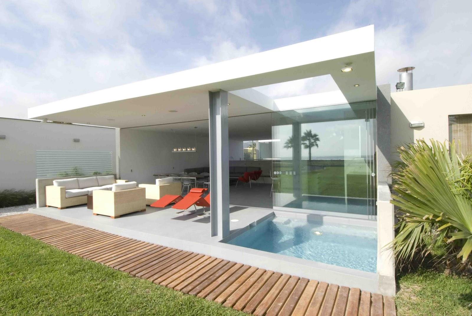 Habitar casa en la isla for Casa con piscina quebrada alvarado