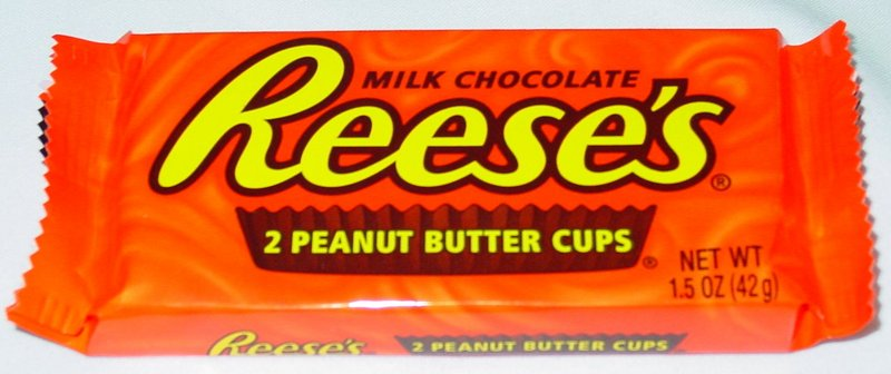 love peanut butter cups freakin love reeses pieces hahaha reeses