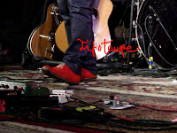 Teddy Thompson's red shoes