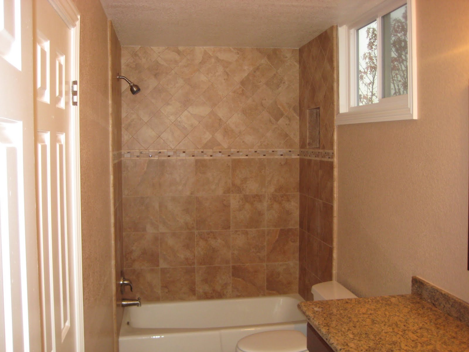 Diagonal tiles above border hmmm bathroom tile ideas for Bathroom walls designs