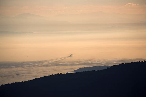 Cruise ship sets off from Vancouver at sunset heading up the Inside Passage to Alaska stock image