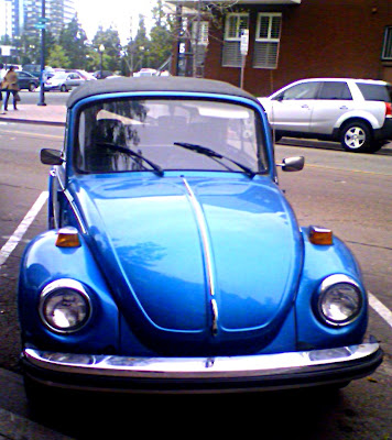 Blue Convertible V. W. Beetle with Karrman Logo