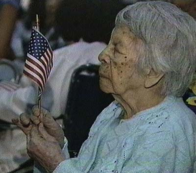 101 year old woman waving American flag, waiting to become U.S. citizen; 1996 photo by CNN