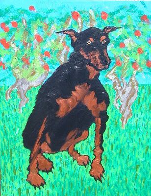Doberman in meadow with fruited trees in background.