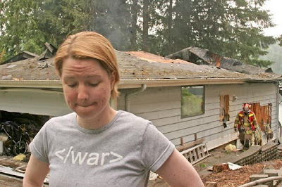 Darcy Burner outside her home which has just burned down. July 1, 2008. photo Ellen M. Banner/The Seattle Times.