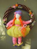 Muñeca en el columpio