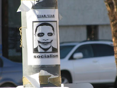 sign that says liar/liar socialism with a picture of President Obama wearing joker makeup