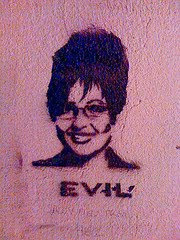 photo from alley with image of sarah palin with evil written below