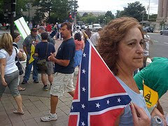 teabaggers at protest, one with confederate flag