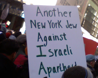 sign saying, another New York Jew against Israeli apartheid