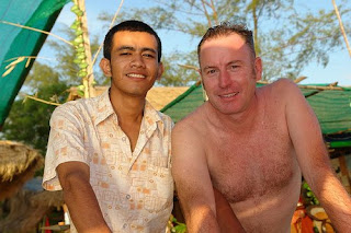 hunk at beach bar with employee