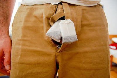 guy with teabags in front of his balls