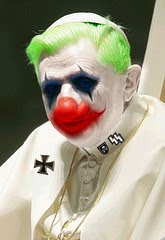 Ratzi wearing clown makeup, his Nazi medals, and a white dress