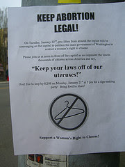 flyer defending abortion rights featuring no symbol across a coat hanger