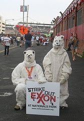 guys in polar bear suits with sign that says Strike Out Exxon