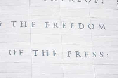 stone carving that says freedom of the press