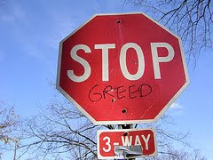 stop sign modified to say stop greed