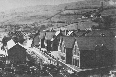 Aberfan PantGlas School before the criminal act of complacency..144 Children and Teachers were moved from this School to the lower field on the leftside of this Mountain view...the cemetery...see below
