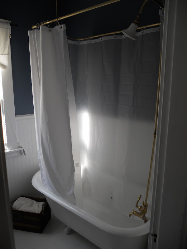 downstairs bathroom functions as guest bathroom as well this bathtub title=