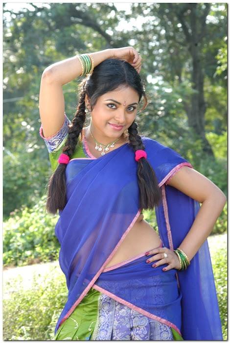 meenakshi girl ing her on half saree hot images