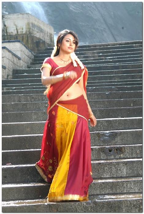 meenakshi girl ing her on half saree