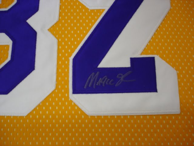 we can take your jersey and sew mount it in different ways here is just one of the various options as this has a magic johnson signature to be shown