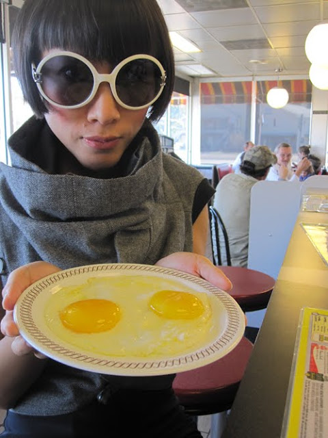 Big, white, round sunglasses