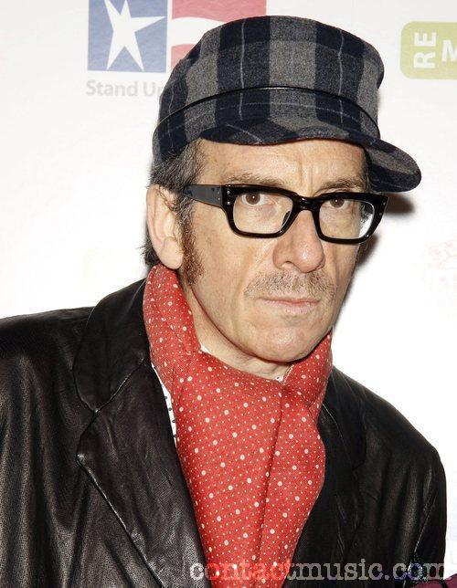 Elvis Costello wear some very good glasses but who are they by?