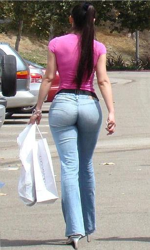 A woman in pink top and ultra tight jeans showing great butt in this candid picture