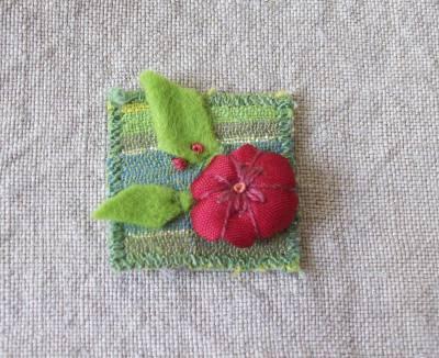 Inchie  mit roter Blume