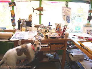 studio Muse at drawing table