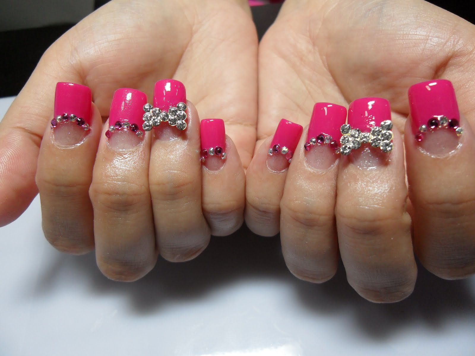 Rhinestone nail design with cross