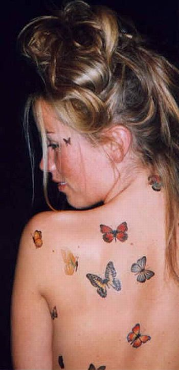 He looks at the infected woman's arm. infected woman's butterfly tattoo