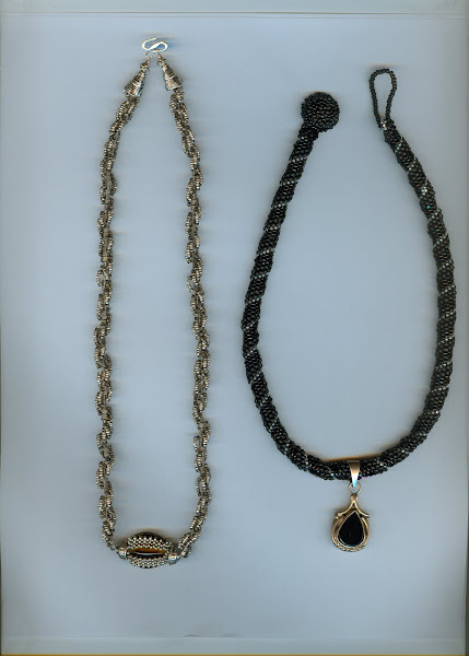 2 Necklaces,sterling and hand blown bead 2 peote chain and black obsidian,sterling silver